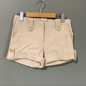 5/15$ Seductions Beige Pleated Button Shorts
